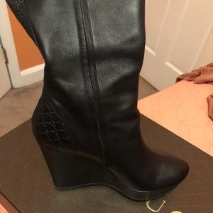 Black leather Gucci knee high boots